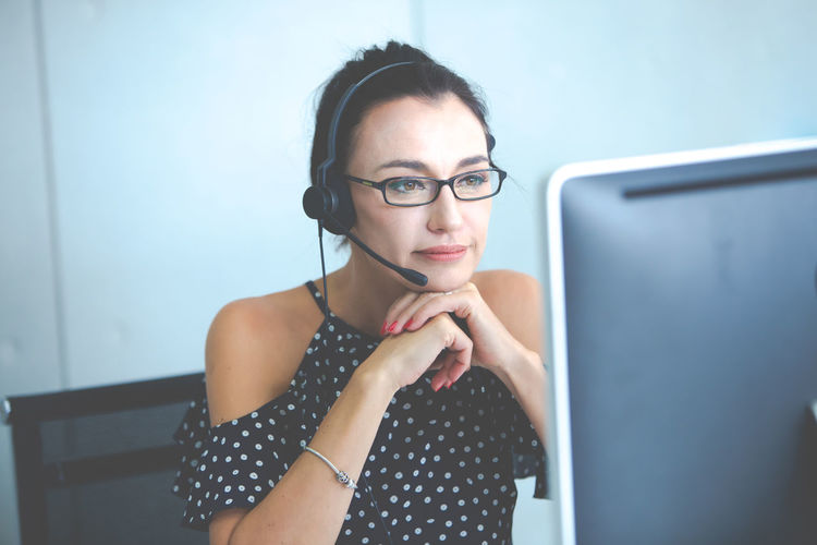 Close-up of woman wearing eyeglasses working in office