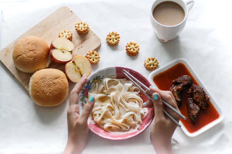 Breakfast Time Breakfast Flat Noodles Using Chopsticks Asian Breakfast Top View Of Food Lifestyle Indoors  Eating Copy Space Flat Lay Soft Focus Blue Nail Polish  Domestic Life Early Morning Drink Homemade High Angle View Sweet Food Food And Drink Served Prepared Food