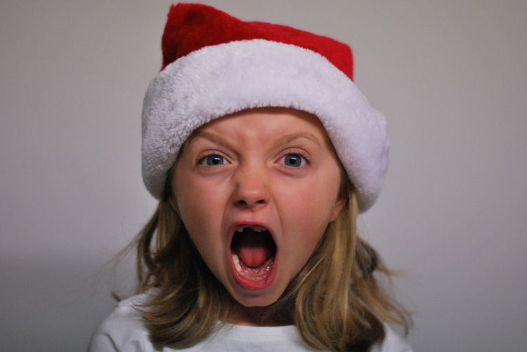 Close-up portrait of girl shouting