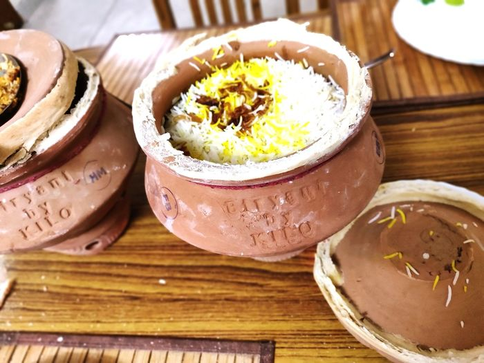 Indian Dum Briyani Delicacy DeliciousFood  Amazing Colors Saffron Rice With Mutton Mouthwateringfood Delicacy Of India Must Taste Earthenware Ancient Way Of Cooking Rice Looking Beautiful 😋 Basmati Rice Long Grain Serving Dish Served With Curry City Bowl Plate Close-up
