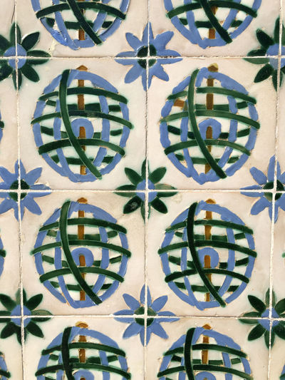 Full frame close up of tiled wall in Lisbon, Portugal Lisbon Portugal Tile Ceramic Tiled Pattern Full Frame Backgrounds Design No People Close-up Wall - Building Feature Floral Pattern Art And Craft Indoors  Creativity Flooring Shape Multi Colored Day Geometric Shape Abstract Built Structure Tiled Floor