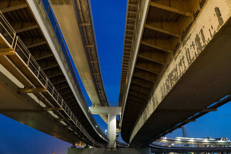 Architectural Column Architecture Below Blue Bridge Bridge - Man Made Structure Building Exterior Built Structure City Connection Day Elevated Road Engineering Long Low Angle View Multiple Lane Highway Nature Outdoors Overpass Road Sky Transportation Travel Underneath EyeEmNewHere