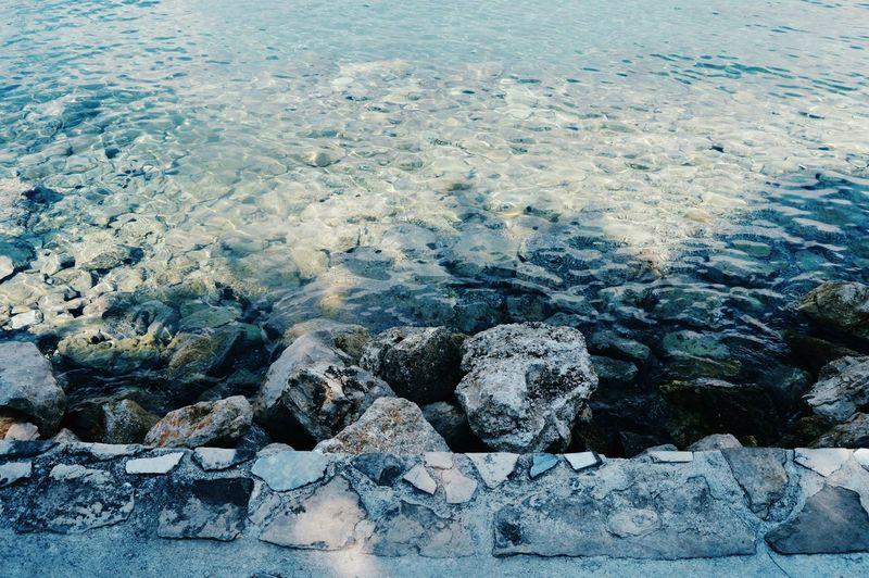 Close-up of boulders at shore