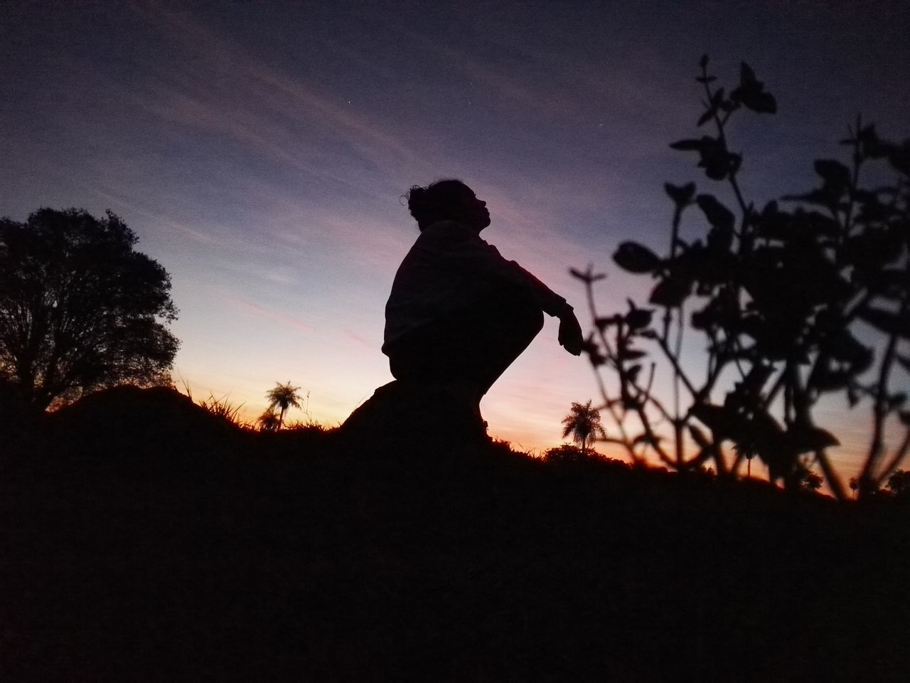 silhouette, sunset, real people, one person, nature, beauty in nature, sky, tranquility, tranquil scene, leisure activity, side view, outdoors, landscape, full length, standing, scenics, lifestyles, men, tree, day, people