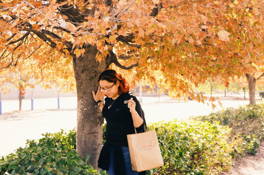 Autumn Beauty In Nature Branch Casual Clothing Change Day Flower Freshness Growth Leaf Leaves Leisure Activity Lifestyles Long Hair Nature Outdoors Park - Man Made Space Person Plant Scenics Season  Tranquility Tree Young Adult Young Women