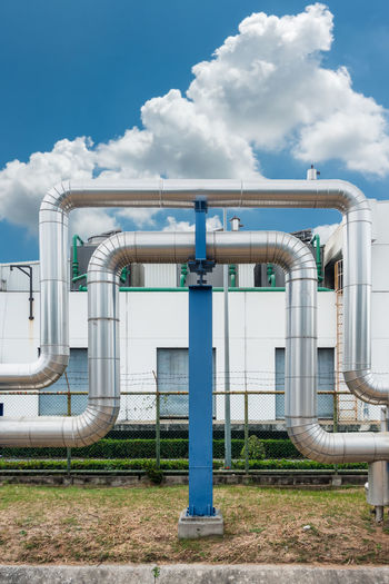 Pipe insulation Distribution Pipeline Architecture Building Exterior Built Structure Chrome Cloud - Sky Day Facility Factory Factory Building Industial Industry Insulation Manufacturing Outdoors Pipe - Tube Pipe Support Sky Steel
