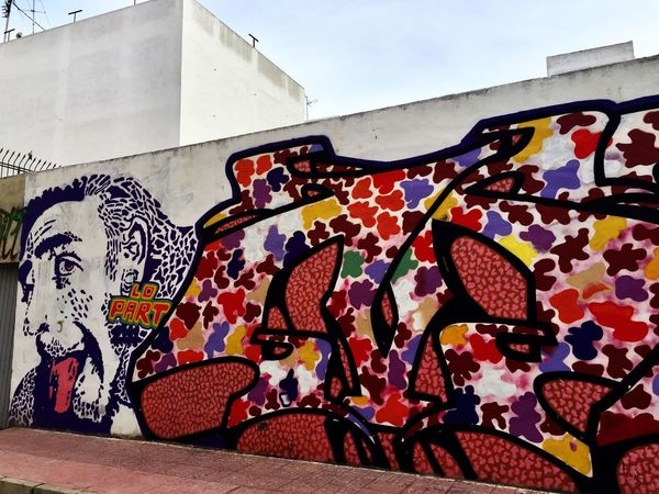 Graffiti Art And Craft Creativity Street Art Multi Colored Building Exterior Outdoors Day No People Built Structure Architecture City ArtWork Sky Walking Around Walking In The Street