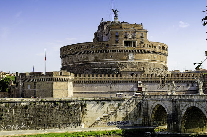 the Castel Sant'Angelo mausoleum of Hadrian in the heart of Rome, Italy. Adriano Archeology Architecture Architecture Bridge Bridge - Man Made Structure Built Structure Castel Sant'Angelo Castle City Day Fortress History Landmark No People Old Outdoors Prison Roma Sant'angelo Sky Tevere River Tomb Travel Destinations Water
