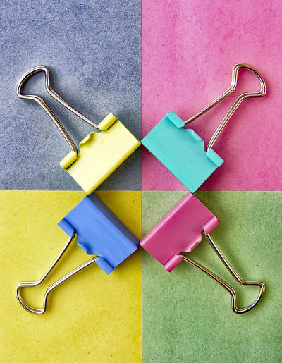 Directly above shot of colorful binder clips on table