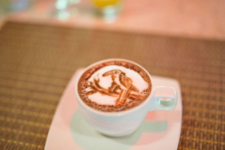 Close-up of froth art on cappuccino