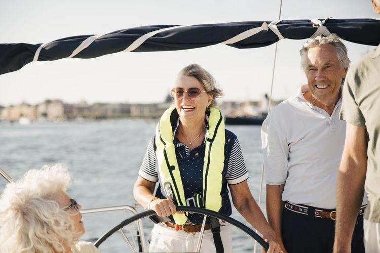 People on boat against sea