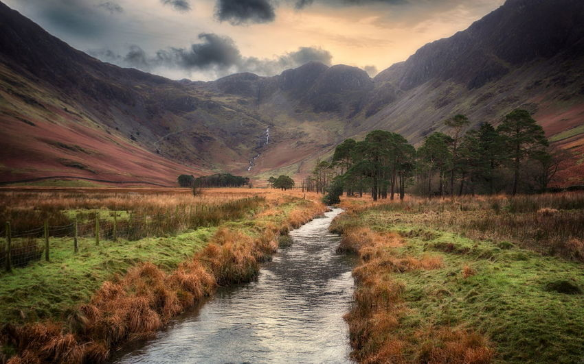 The river feeding Lake Buttermere in the English Lake District Autumn English Lake District Beauty In Nature Buttermere Lake Day Grass Landscape Mountain Mountains Nature No People Outdoors Plant River Scenics Sky Stream Tranquil Scene Tranquility Tree