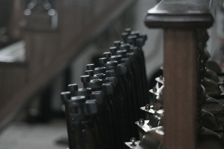 Close-Up Of Rifles Arranged Indoors