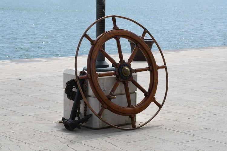 Bicycle wheel on beach