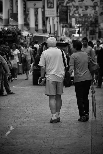 Togetherness Walking Rear View Women Real People City Life Adults Only Full Length People Crowd Day Outdoors Malaysia Petaling Street Black And White Monochrome Street Photography Couple Lifestyles A Day Shopping Arm In Arm Married Growing Old Together Partners The Street Photographer - 2017 EyeEm Awards