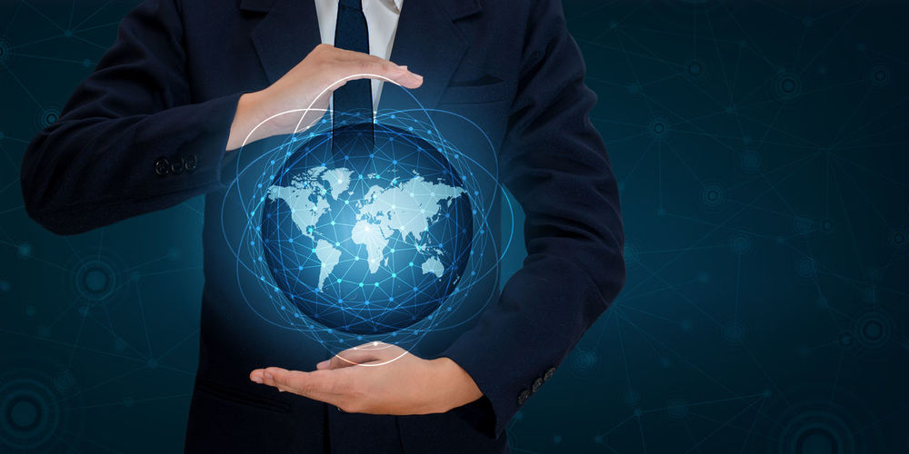 Digital composite image of businessman with globe