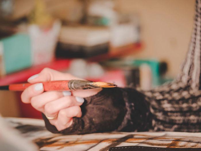 Cropped Hand Holding Paintbrush