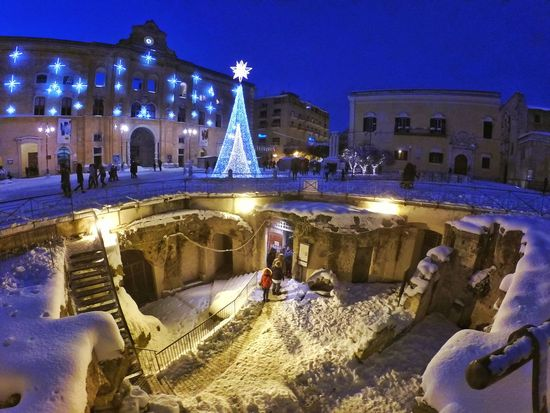 Winter Snow Cold Temperature Illuminated Architecture Travel Destinations Building Exterior Night Outdoors Snowing No People Sky Ice Rink Christmas Market Matera Italy Italia