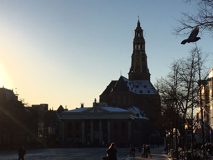 """Groningen , The Netherlands . Here, at the Vismarkt , the Korenbeurs and behind it, De Aa Kerk . At the back is the entrance of the church, it has the sign """"SPQG"""" (Senatvs Popvlvsqve Groninga). That is what the Romans placed in cities under their direct control, yet the Romans never conquered Groningen , nor did they found the city. Although, Latin is the the language of the intelligen and sounds rather cool. The Purist (no Edit, No Filter) Sunset View"""