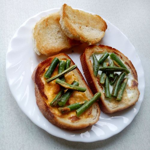 High Angle View Of Breads With Green Beans Served In Plate