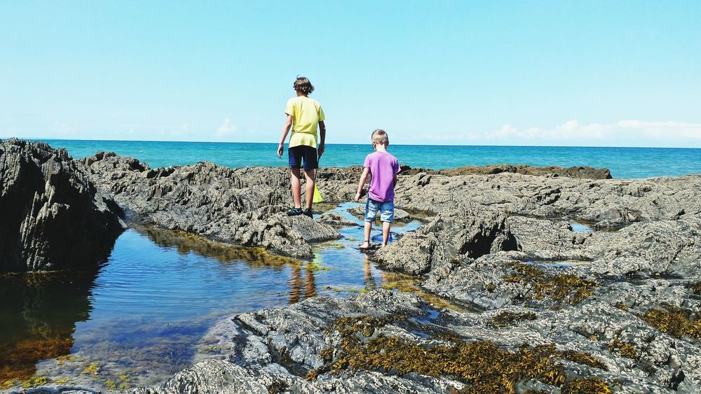Hanging Out Boys Beach Beach Photography Beach Life Rocks Rockpools Rockpooling Devon Coast Devon Ocean Blue Sky People And Places