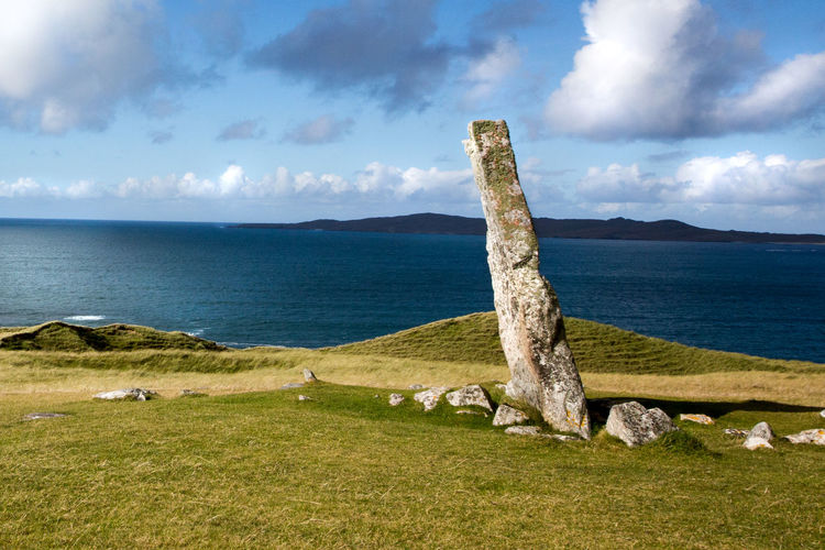 Ancient Religious Site Clach Mhic Leoid Cloud - Sky Historic Monument Horgabost Horizon Over Water Look To Isle Of Taransay MacLeod's Stone Neolithic Stones No People Scottish Scenery Standing Stone