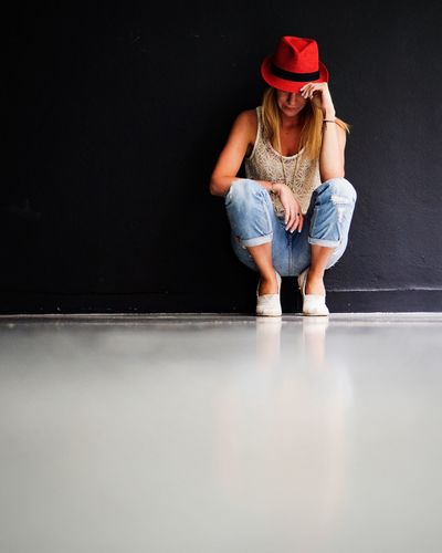 Sad woman against a black wall