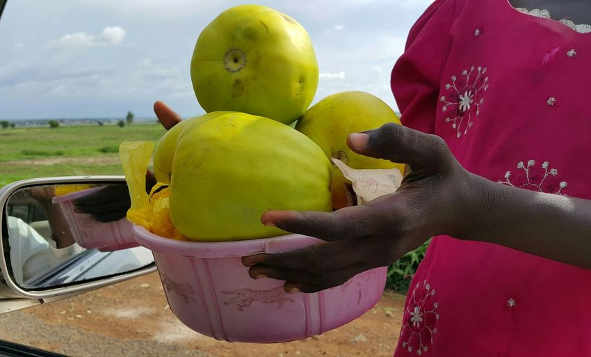 Midsection of woman selling fruit