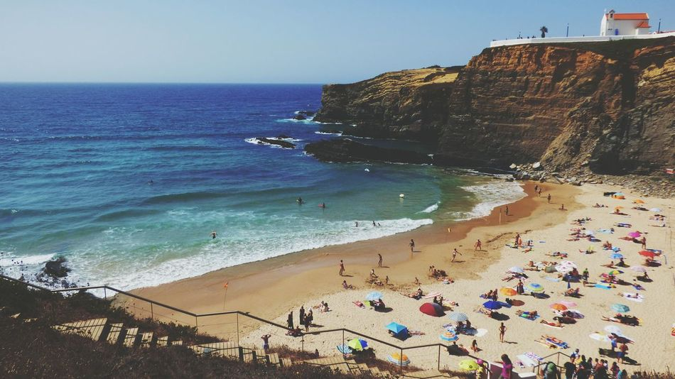 Large Group Of People Vacations Sunny Wave Scenics People Summer Views Summer 2017 Summer Beach Sea Water Sand Clear Sky Rock Formation Beauty In Nature Zambujeira Do Mar