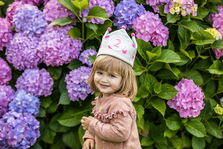 Portrait of smiling girl with pink flowers