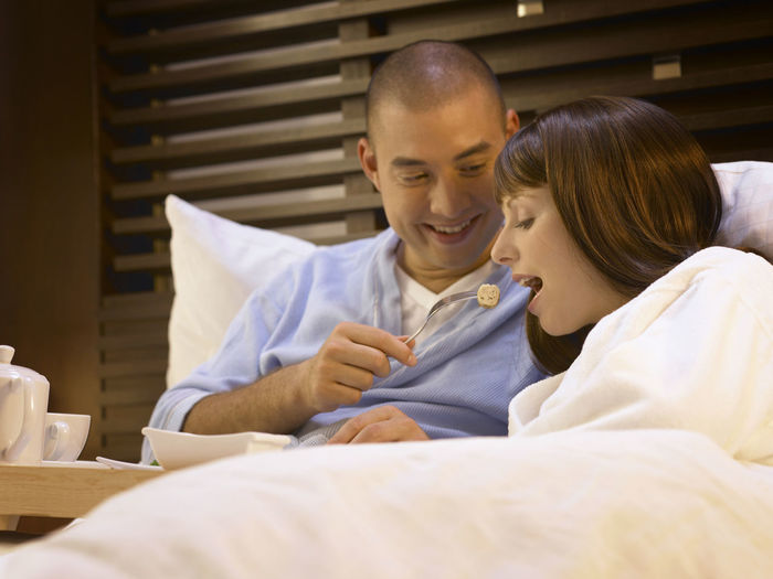 couple breakfast on the bed Eating Food And Drink Happiness Holiday Love On The Bed Vacations Woman Bedroom Bonding Breakfast On The Bed Close-up Couple - Relationship Honeymoon Leisure Activity Lifestyles People Real People Relaxation Smiling Togetherness Two People Young Adults Young Couple Young Women