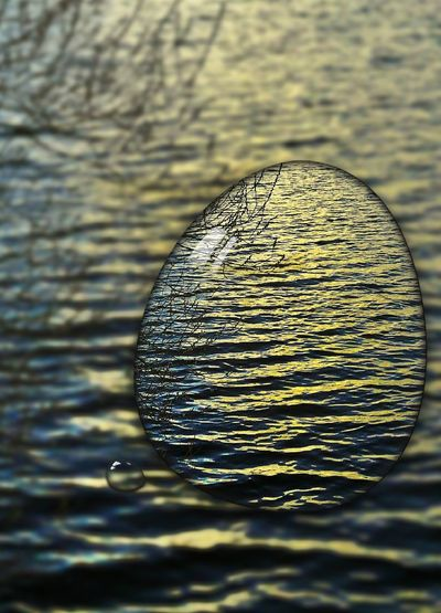 Happy Eastern!!! Playing With Effects Water Into The Sunset Deep Sunlight Reflection Rippled Close-up Nature Shiny Golden Hour Gold And Blue Outdoors Day No People Germany🇩🇪 Cut And Paste The Creative - 2018 EyeEm Awards