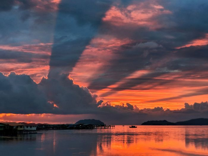 evening rays Tranquility Tranquil Scene Idyllic Sabah Borneo Beautiful Dawn Rays Lightrays Sunset Water Sunset Red Reflection Orange Color Sky Cloud - Sky