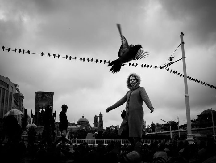I feel I can fly A New Perspective On Life Sky Cloud - Sky Real People Flying Group Of People Bird Animal Wildlife Built Structure Crowd Group Of Animals Women Watching Flock Of Birds Nature The Art Of Street Photography