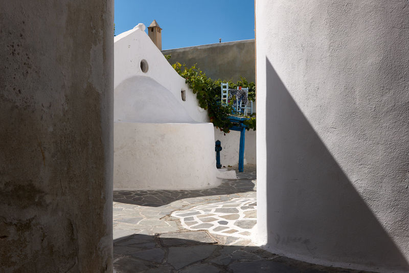 Naxos Town Architecture Building Building Exterior Built Structure Day Footpath Incidental People Leisure Activity Lifestyles Nature Outdoors People Real People Shadow Sunlight Sunny Wall Wall - Building Feature