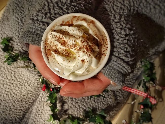 Hot Chocolate Human Body Part Human Hand One Person High Angle View Food And Drink Holding Wipped Cream Cream Hot Drink Hot Beverage Real People Women Lifestyles Drink Indoors  Leisure Activity Close-up Frothy Drink Day Freshness Low Section One Woman Only