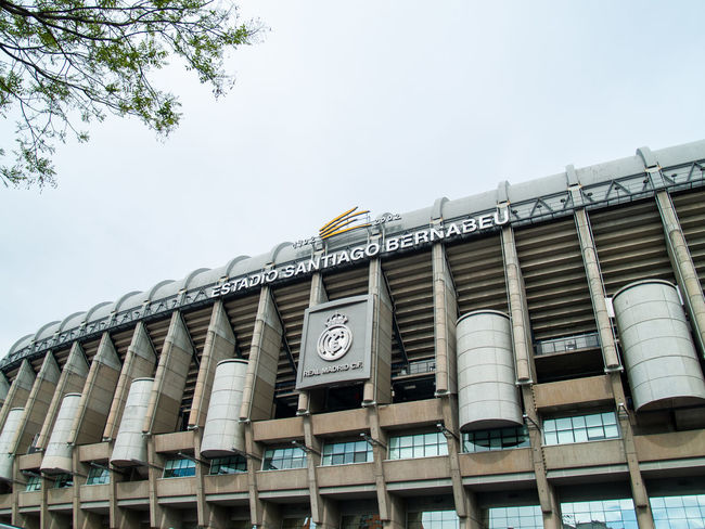 Architecture EyeEm Best Shots EyeEmNewHere Football Geometric Architecture Santiago Bernabéu Stadium Sport In The City Stadium Teamwork Urban Lifestyle Architectural Column Architectural Feature Architecture Building Building Exterior Built Structure Business Clear Sky Copy Space Day Factory First Eyeem Photo Geometric Abstraction In A Row Industry Lifestyles Low Angle View Nature No People Office Building Exterior Outdoors Santiago Bernabeu Side By Side Sky Sport Sport Building Still Life Team Team Sport Window