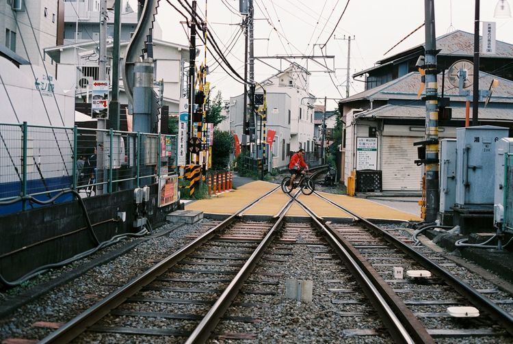 Analog Bicycle City Life Diminishing Perspective Film Film Photography Fujifilm Japan Kamakura Leading Mode Of Transport Perspective Public Transportation Rail Transportation Railroad Crossing Railroad Station Railroad Station Platform Railroad Track Railway Track Rider Riding Train Transportation Travel Urban
