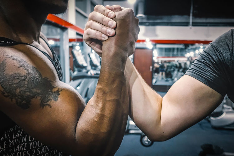 African Ethnicity Close-up Diversity Exercise Exercising Fitness Gym Hands Handshake Health Indoor Indoors  Lifestyles Male Man Muscle People Recreation  Sport SUPPORT Team Teamwork Training Unity Workout
