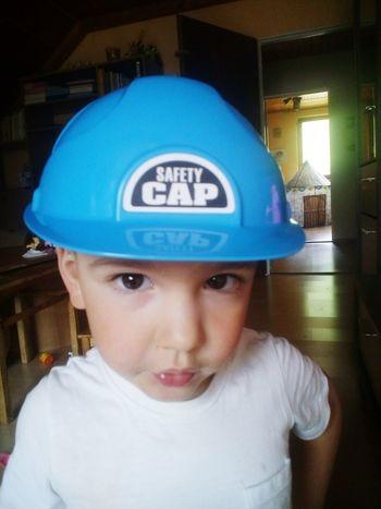 little builder Boy Son Blue Portrait Looking At Camera Headshot Front View Close-up Cap Wearing Pretty Children