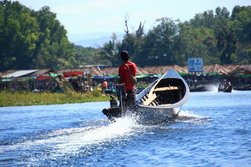 Rear view Transport Waft Drift Community Asian  Asianstyle Lake Inle Lake Myanmar Nyaungshwe Outdoors Rural Scene Rural Scenes Countryside People Staytogether Crowded Lifestyles Myanmarstyle Water Extreme Sports Sport Nautical Vessel Adventure Motion Women Oar Sky