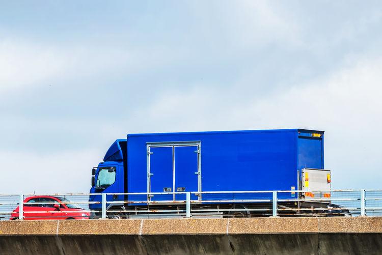 Blue train against sky
