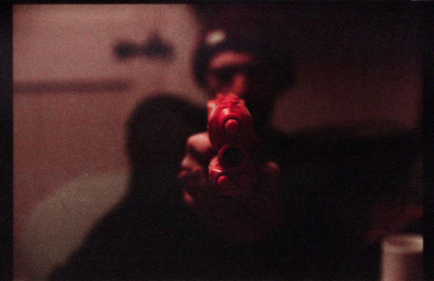 Nerf Gun wars - The Battle Royale Action Dark Darkness And Light Depth Of Field EyeEm Best Shots Film Film Photography Filmcamera Filmisnotdead Filmphotography Foam Friends Nerf Nikkormat FS (1965) Orange Playing Showcase April Spooky Tadaa Community Taking Photos Taking Pictures War