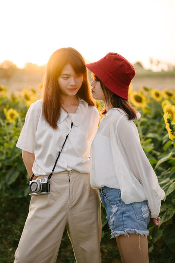 Two brother in the sunflower field Jidpipat_Photo Three Quarter Length Leisure Activity Togetherness Standing Two People Real People Land Women Bonding Casual Clothing Hairstyle Field Nature Lifestyles Sky Young Adult Young Women Front View Hair Positive Emotion Outdoors Sunflower Shooting Photos Sunset Capture Tomorrow EyeEmNewHere My Best Photo