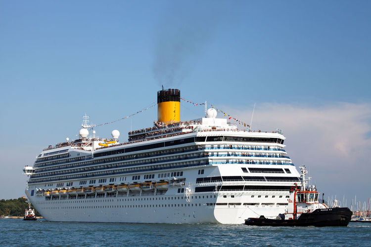 Low angle view of cruise ship on sea against blue sky