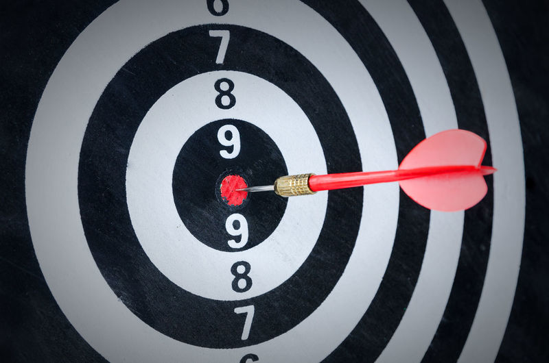 Close-up of arrow on dartboard