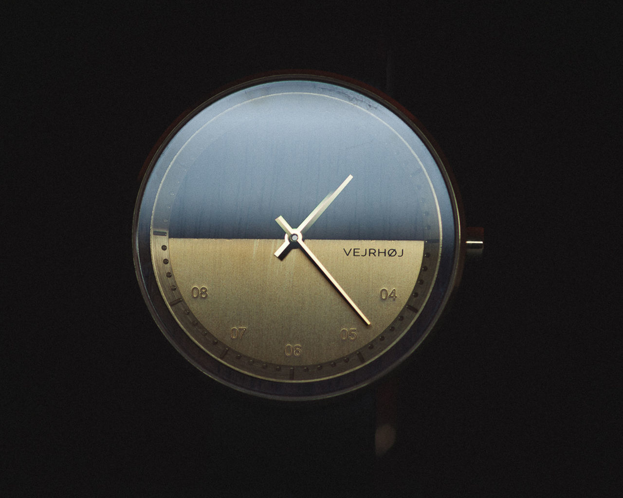 CLOSE-UP OF CLOCK ON BLACK BACKGROUND