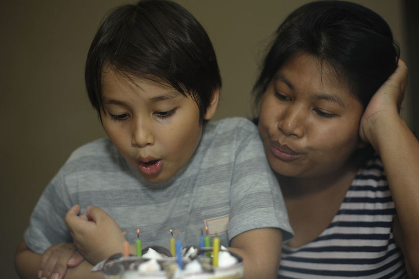 Mother and son celebrating birthday blowing candles on a cake Celebration Happiness Happy Happy People Love Mother And Son Birthday Blowing Candles Bonding Candle Celebrating Child Childhood Close-up Family Headshot Indoors  Kid Real People Togetherness