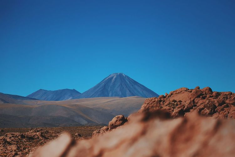 Distant View Of Mountain At Atacama Desert Against Clear Blue Sky