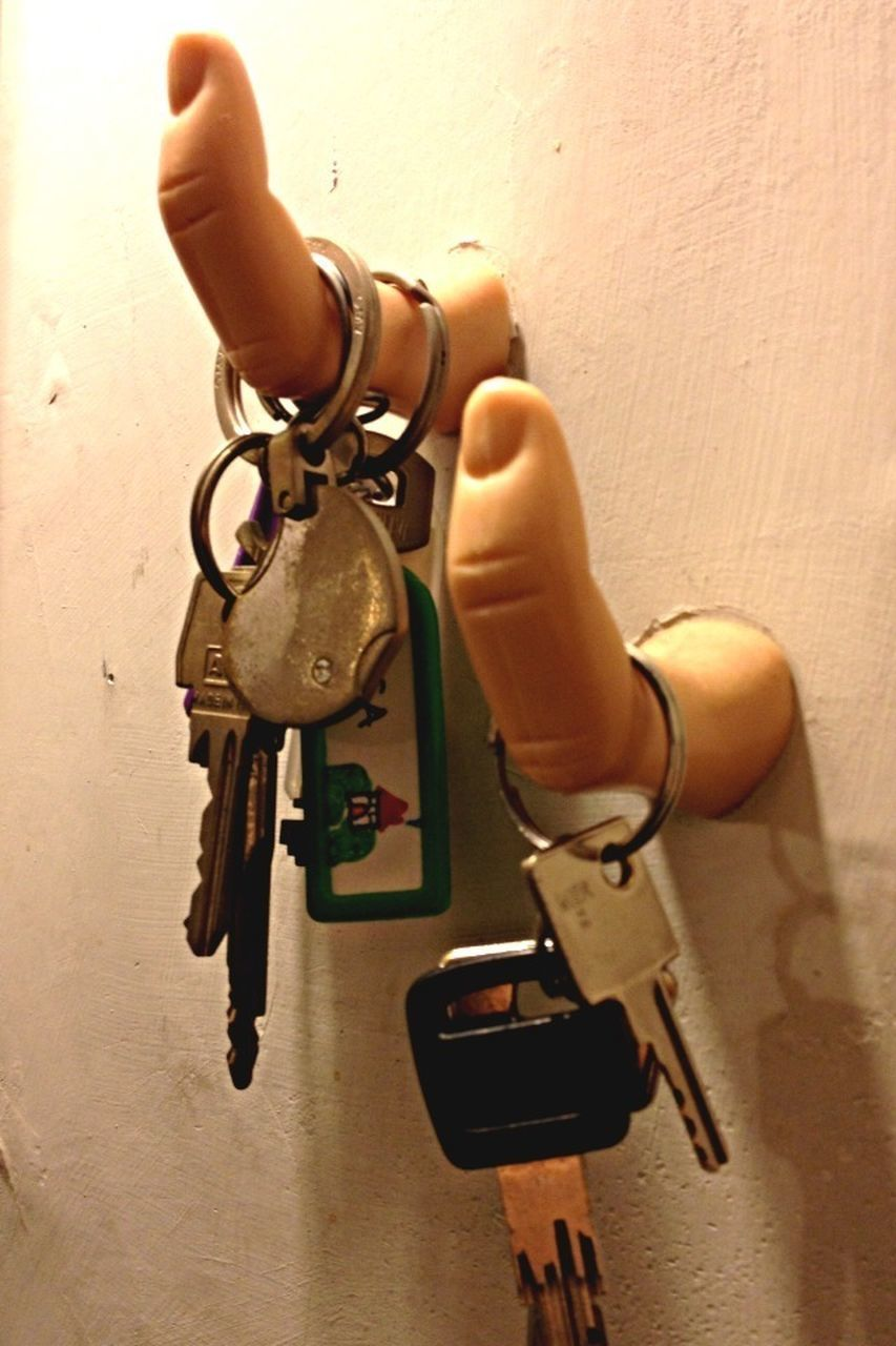 human hand, key, key ring, human body part, lock, one person, holding, close-up, real people, hanging, indoors, day, people